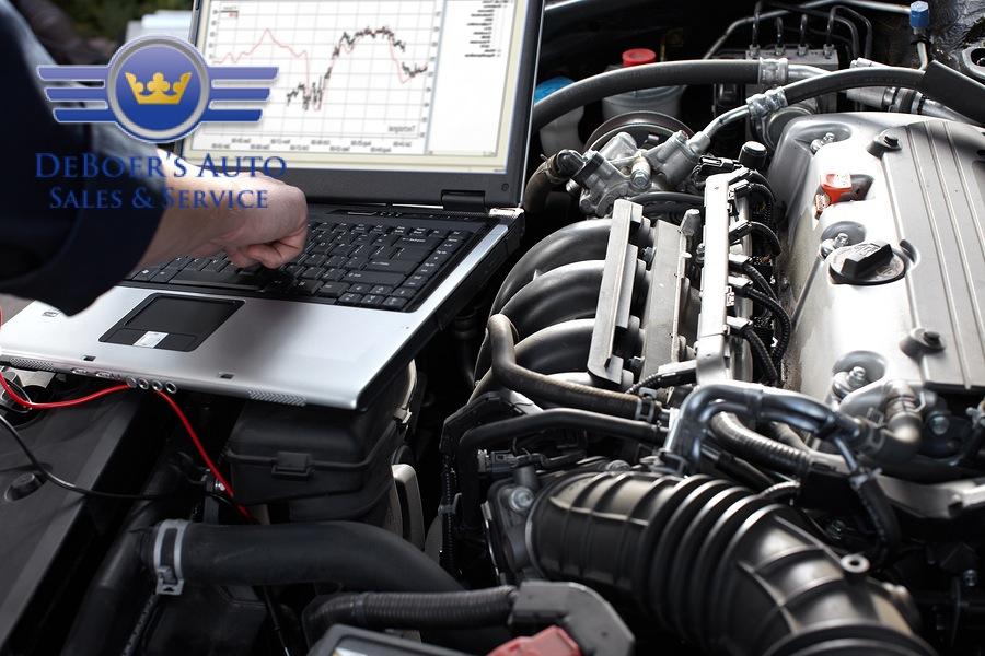 bigstock-Professional-car-mechanic-work-39017251