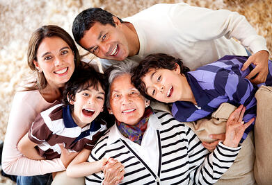 Grandmother and her family looking happy at home