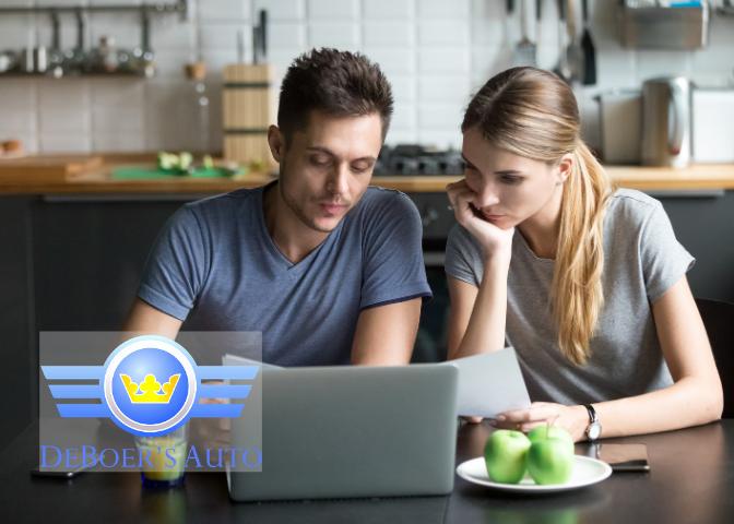 couple budgeting on computer