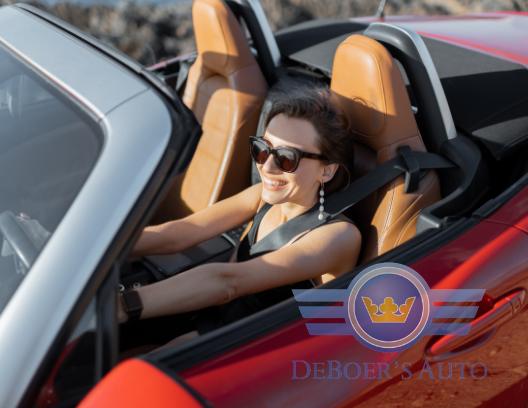 happy girl driving convertible