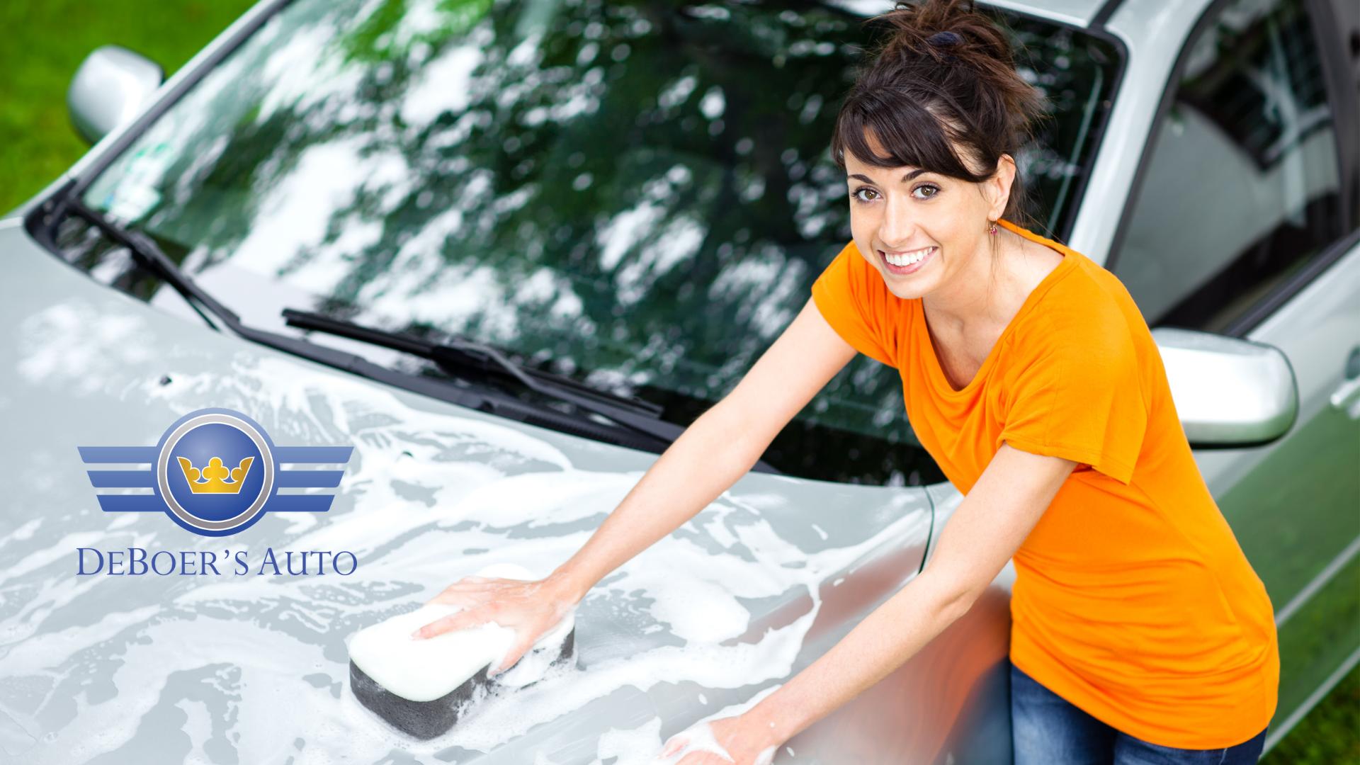 women washing car